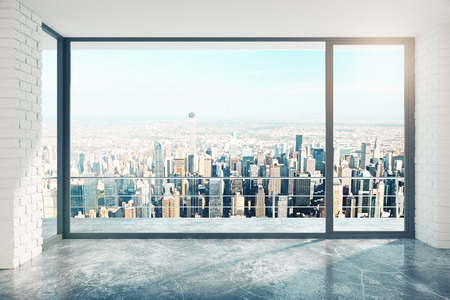 balcony window: Empty loft room with big window in floor and city view Stock Photo