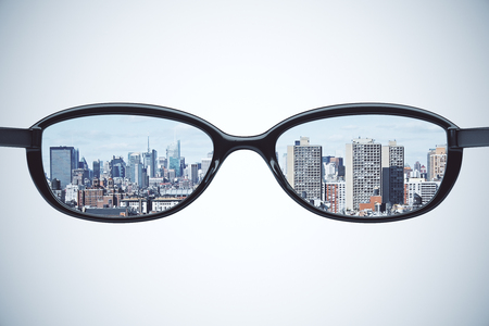 megapolis: Clear vision concept with eyeglasses with megapolis city at white background Stock Photo