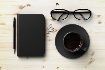 diary cover: Black blank diary cover, black cup of coffee and glasses on wooden table, mock up