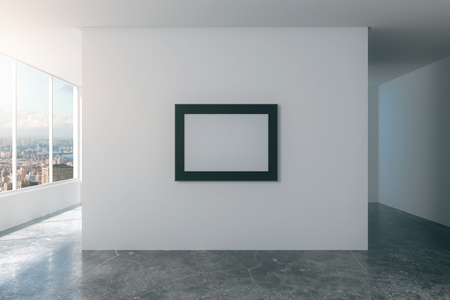 concrete room: Blank picture frame on white wall in empty loft style room with city view and concrete floor, mock up