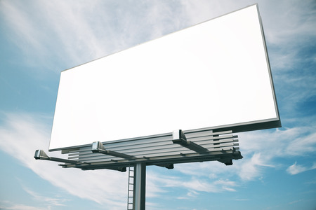 up: Blank billboard at blue sky backgound, mock up Stock Photo