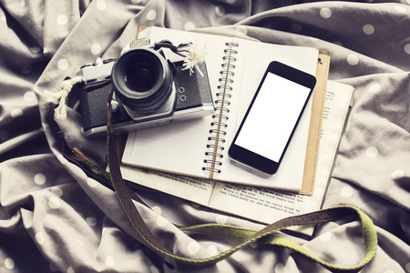 publicist: Blank cell phone screen with old style camera, diary and book, mock up