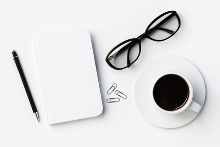 diary cover: White blank diary cover, cup of coffee and glasses on white table, mock up