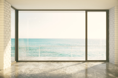 Empty loft room with big window in floor and ocean view