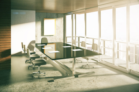 Modern loft style conference room with furniture at sunrise Stock Photo