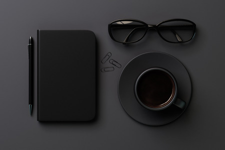 diary cover: Black style concept with black blank diary cover, black cup of coffee and glasses on grey table, mock up