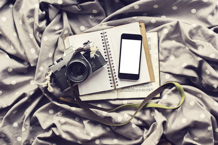 publicist: Blank white smartphone screen with old style camera and diary, mock up