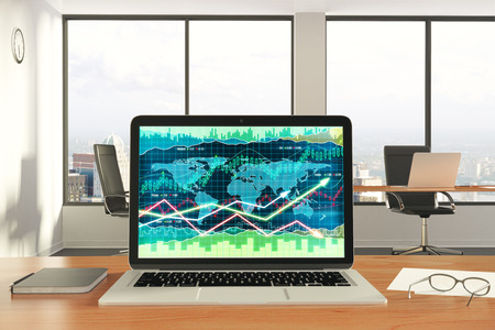 Business chart at laptop screen with diary and eyeglasses on wooden table