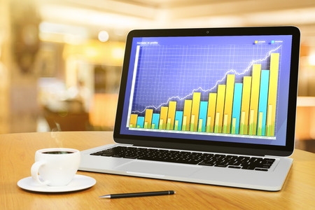 growth chart: Business graph with cup of coffee and pen on wooden table