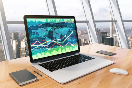 Business chart on laptop screen with diary and cell phone on wooden table
