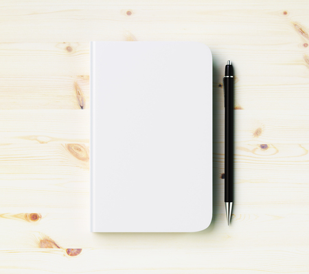 diary book: Blank white diary cover with pen on wooden table, mock up