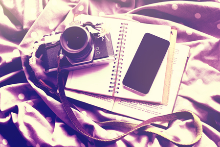 publicist: Cell phone with vintage camera, diary and book, mock up Stock Photo