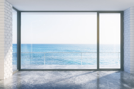 open windows: Empty loft style with concrete floor and ocean view Stock Photo