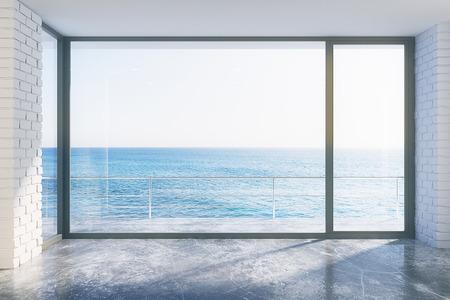 ventanas abiertas: estilo loft vacío con el suelo de cemento y vista al mar