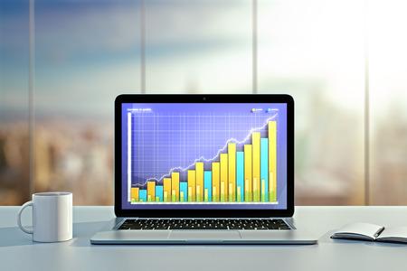 一杯のコーヒーとオフィスの日記と画面上にビジネス グラフとノート パソコン