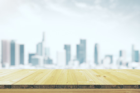 room background: Empty wooden table with a blurred background of the city