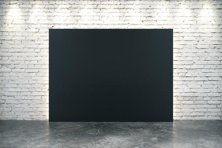 concrete background: Big blank black canvas on concrete floor at white brick background