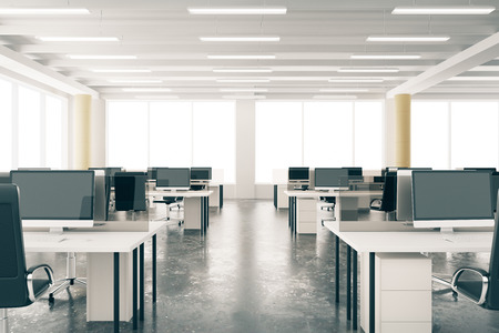 Modern open space loft office with furniture, concrete floor, big windows and pillars
