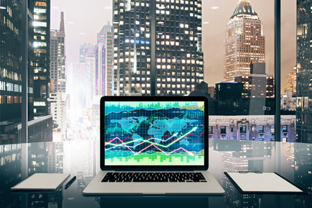 megapolis: Business graph on laptop screen on glassy table in modern office with night megapolis city view