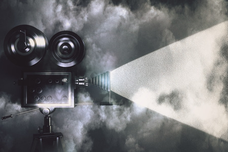 movies: Vintage camera making a film in the dark room with clouds
