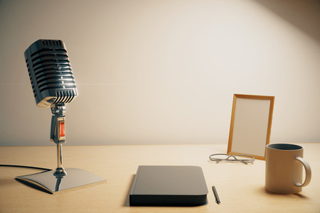 commentator: Radio microphone with diary, cup of coffe and blank picture frame, mock up