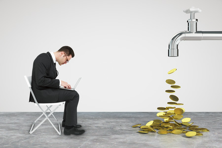 passive earnings: Working businessman with laptop and faucet from which the money flow