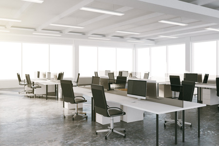 Open space loft office with furniture and big windows