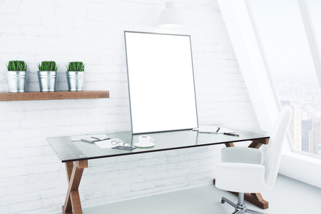 mocks: Blank white picture frame on glassy table in modern white style room, mock up Stock Photo