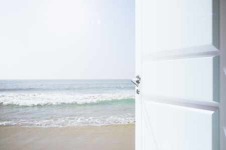 open palm: Opened white door to a beachway with ocean