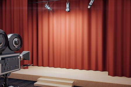 red abstract backgrounds: Empty stage with red scenes, spotlights and vintage movie camera Stock Photo