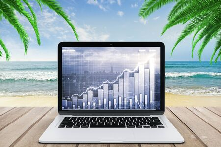 laptop screen: Double explosure with business chart and city view on laptop screen on wooden bench at the beach with ocean