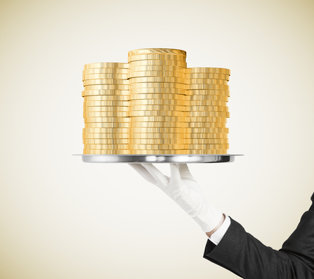 white glove: Man hand in white glove with a tray with gold coins