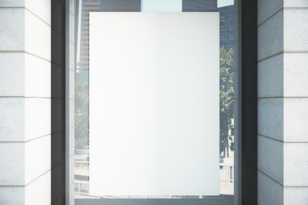 Blank white poster on the window, mock up