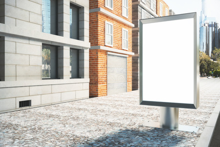 Blank white billboard on the street on a sunny day, mock up