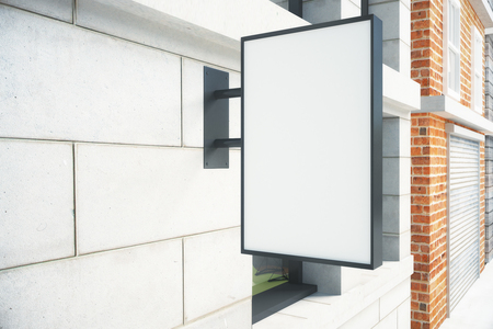 mocked: Blank white signboard on the wall outdoor, mock up