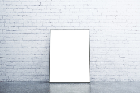 mocks: Blank white picture frame on concrete floor in empty room with white brick wall, mock up
