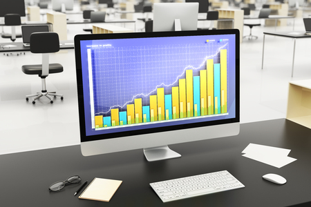 other space: Business graph on computer screen on wooden table with other accessories in open space office Stock Photo
