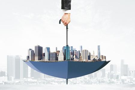 upside down: Cityscape upside down umbrella concept Stock Photo