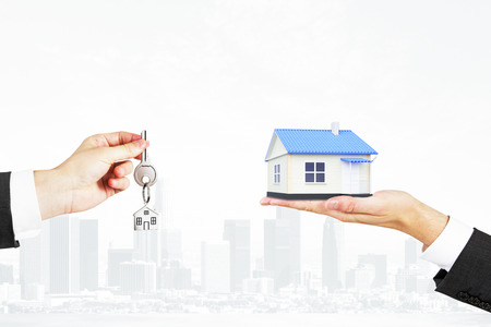 Selling real estate concept with a house and key Stock Photo