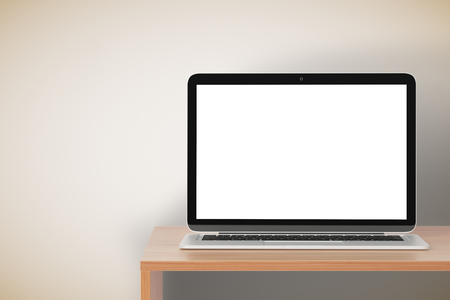 Blank laptop screen on wooden table at wall background, mock up Imagens