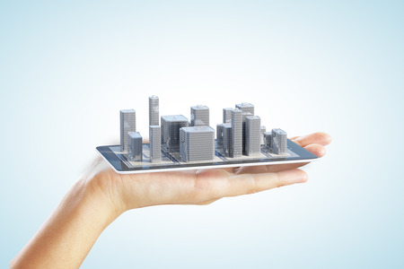 buildings city: 3D city buildings on smartphone and man hand Stock Photo