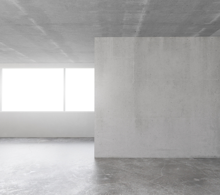 Empty loft room with concrete floor and ceiling and concrete wall in the middle