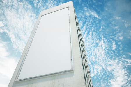 up: Blank white billboard on the wall of high building with blue sky, mock up