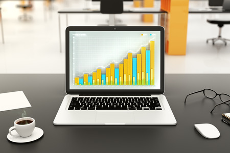 office desk: Business chart on laptop screen with office accessories on black table