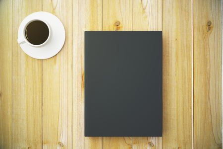 diary cover: Blank black diary cover with cup of coffee on wooden table, mock up