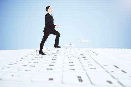 climbing stairs: Businessman climbing stairs keyboard buttons