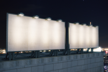 urban background: Two big empty billboard on the background of the city at night, mock up
