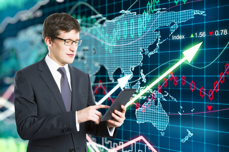 forex: Trader works with the market on a digital tablet concept Stock Photo