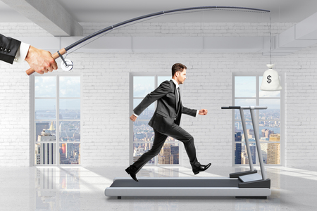 running businessman: Profit-seeking concept with businessman running on a treadmill for a bag of money hanging on a fishing tackle