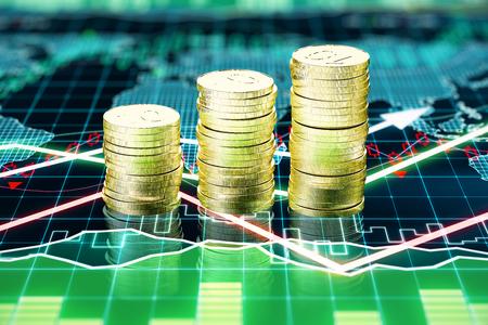 비즈니스 차트 화면에 금화 더미 스톡 콘텐츠